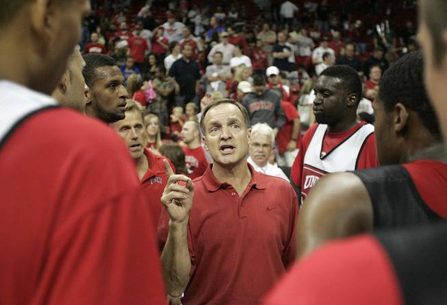 UNLV head coach Lon Kruger talks to his players after the Rebels FirstLook scrimmage Oct. 16 at the Thomas & Mack Center.