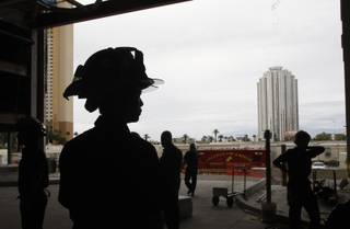 Firefighters, including Clark County firefighter Joe Ly, left, take part in a multi-agency fire training exercise at the stalled Fontainebleau Las Vegas resort project Monday, Oct. 12, 2009. The fire departments want to be sure they are prepared to work together in case of a fire in a high-rise casino.