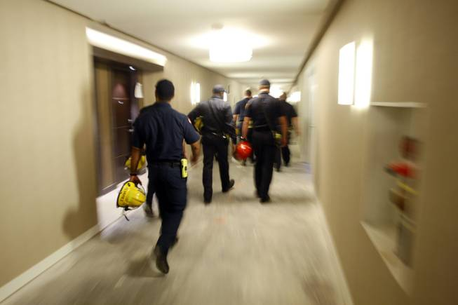 Firefighters go through the a hallway to their next course ...