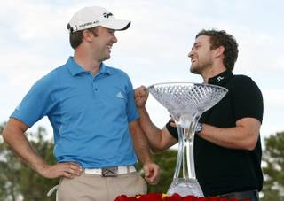 Martin Laird of Scotland jokes with entertainer Justin Timberlake after winning the 2009 Justin Timberlake Shriners Hospitals for Children Open on Sunday, Oct. 18, 2009.