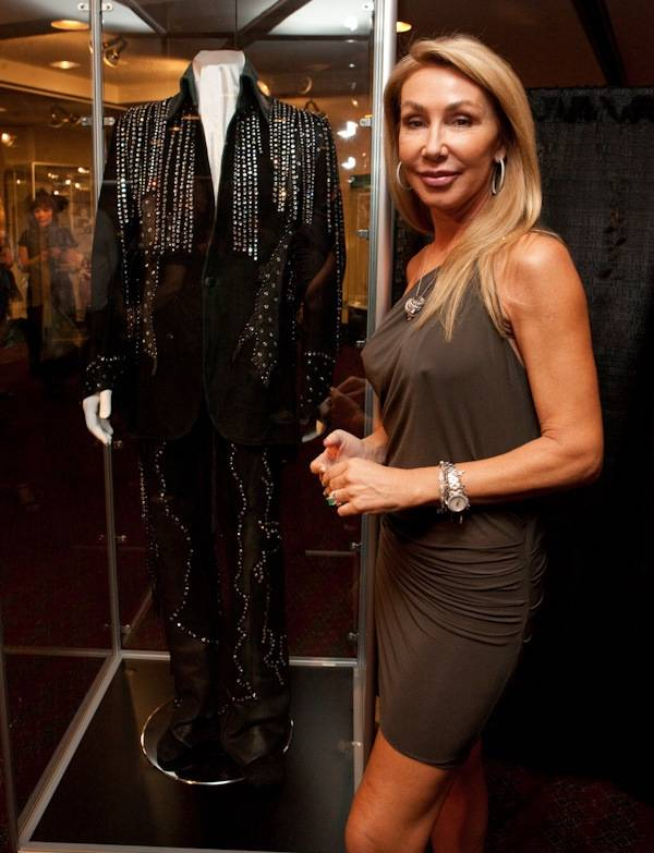 Linda Thompson, Elvis' former girlfriend, with a suit she had designed by Susie Creamcheese for Elvis in 1974 on display at King's Ransom Museum's Elvis Presley exhibit at the Imperial Palace.