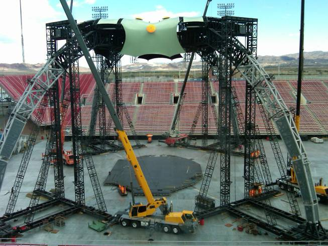Workers erect the massive 360-degree stage for Friday's U-2 concert ...