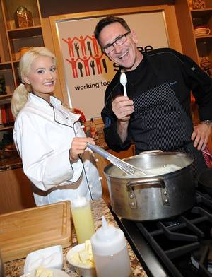 Holly Madison participates in a cooking demonstration led by chef Rick Moonen at Three Square Food Bank.