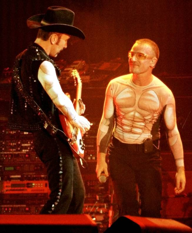 Edge and Bono, rockin' it out in a muscular way at Sam Boyd Stadium in April 1997.