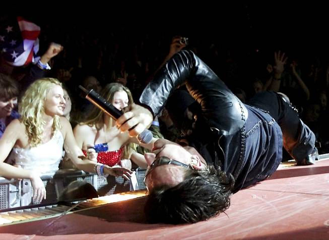 Bono, interacting theatrically during U2's November 2001 show at the Thomas & Mack Center.