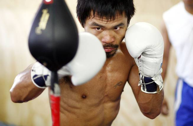 Filipino boxer Manny Pacquiao works out at Freddie Roach's WildCard Boxing Club in Hollywood, Calif., on Oct. 24, 2009.