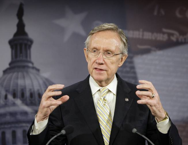 Senate Majority Leader Harry Reid gestures while speaking on health care reform during a news conference, Monday, Oct. 26, 2009, on Capitol Hill in Washington.