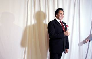 LAS VEGAS - WEDNESDAY, OCTOBER 28, 2009 - Wayne Newton appears on the red carpet as a handler reaches for him to move on during the grand opening night of Wayne Newton's