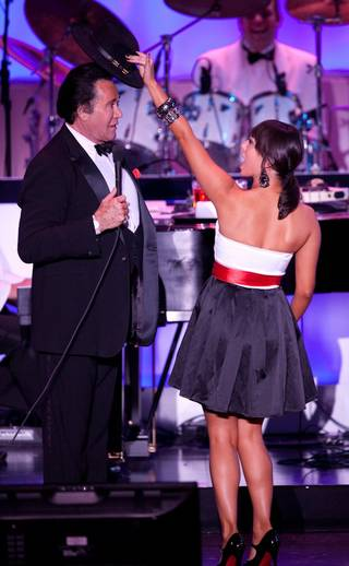 Wayne Newton and Cheryl Burke during his Once Before I Go grand opening show at the Tropicana on Oct. 28, 2009.