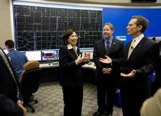 Labor Secretary Hilda Solis, left, talks with Charlie Randall, center, business manager for the International Brotherhood of Electrical Workers Local 396, and Michael Yackira, president and CEO of NV Energy, during a tour of a NV Energy control room Wednesday, Oct. 28, 2009.  Solis announced the award of $138 million in federal stimulus funds to NV Energy for smart grid technology. The money will fund a three-year project to replace electric meters with