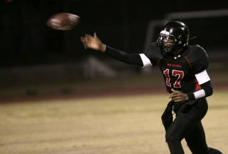 Las Vegas High quarterback Hasaan Henderson throws a pass during the game against Desert Pines Thursday night.  Las Vegas pulled out a 7-6 victory.