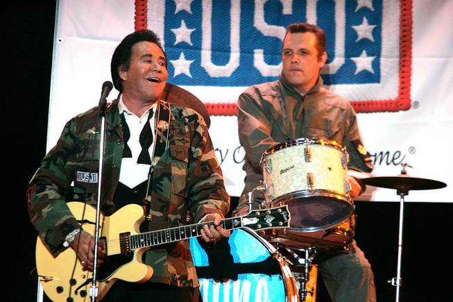 "Wayne Newton performs a simulated USO performance during the grand opening night of Wayne Newton's ""Once Before I Go"" at the Tropicana in Las Vegas Wednesday, Oct. 28, 2009."