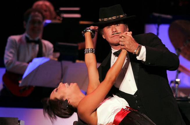 "Wayne Newton performs with his former ""Dancing With The Stars"" partner Cheryl Burke during the grand opening night of Wayne Newton's ""Once Before I Go"" at the Tropicana in Las Vegas Wednesday, Oct. 28, 2009."