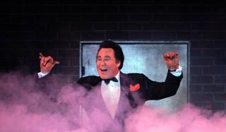 Wayne Newton performs the opening number during the grand opening night of Wayne Newton's