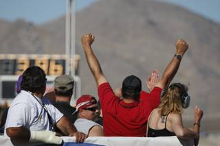 A fan cheers a quarterfinal run during the NHRA Las Vegas Nationals at the Las Vegas Motor Speedway Sunday, Nov. 1, 2009.
