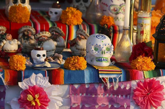 Colorful paper decorations and sugar-coated skulls are on display in many of the altars presented at the annual Life in Death: Day of the Dead Festival at the Winchester Cultural Center and Park, Nov. 1, 2009.
