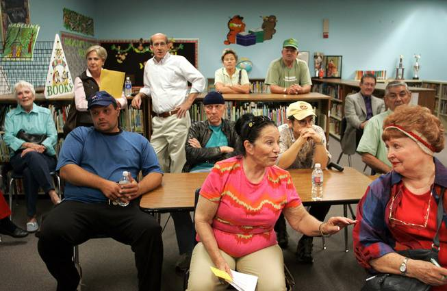 Neighbors of the school gather at Elaine Wynn Elementary School during a community meeting about a proposed health clinic on the school's campus in Las Vegas Monday, Nov. 2, 2009.