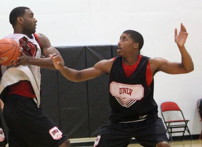 UNLV freshman Justin Hawkins defends Darris Santee during UNLV basketball practice at the Cox Pavilion Monday.