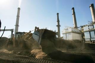 A payloader mixes wood chips with coal at NV Energy's Reid Gardner Station coal-fired power plant Wednesday, Nov. 4, 2009 near Moapa.