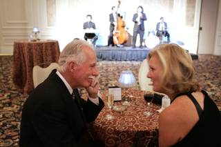 Donor Jon Cobain, the first graduate of UNLV in 1964, talks with his wife Judy Flynn at cocktail hour during the UNLV Foundation Annual Dinner at the Bellagio on Thursday.