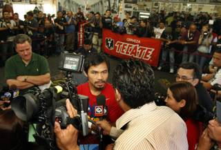 Manny Pacquiao of the Philippines interviewed before a workout at the Wild Card Boxing Club in Los Angeles Wednesday, Nov. 4, 2009. Pacquiao will challenge WBO welterweight champion Miguel Cotto of Puerto Rico for the title at the MGM Grand Garden Arena on Nov. 14.