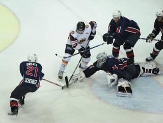 Germany's Thomas Greilinger, second left, and US Lee Sweatt and his teammates Charlie Cook, goalkeeper Jeanmarc Pelletier and Jeff Hamilton, left to right, challenge for the puk during the ice hockey Germany Cup match between Germany and USA in the Olympic hall in Munich, southern Germany, on Friday, Nov. 6, 2009. USA won the match after penalty 3-2.
