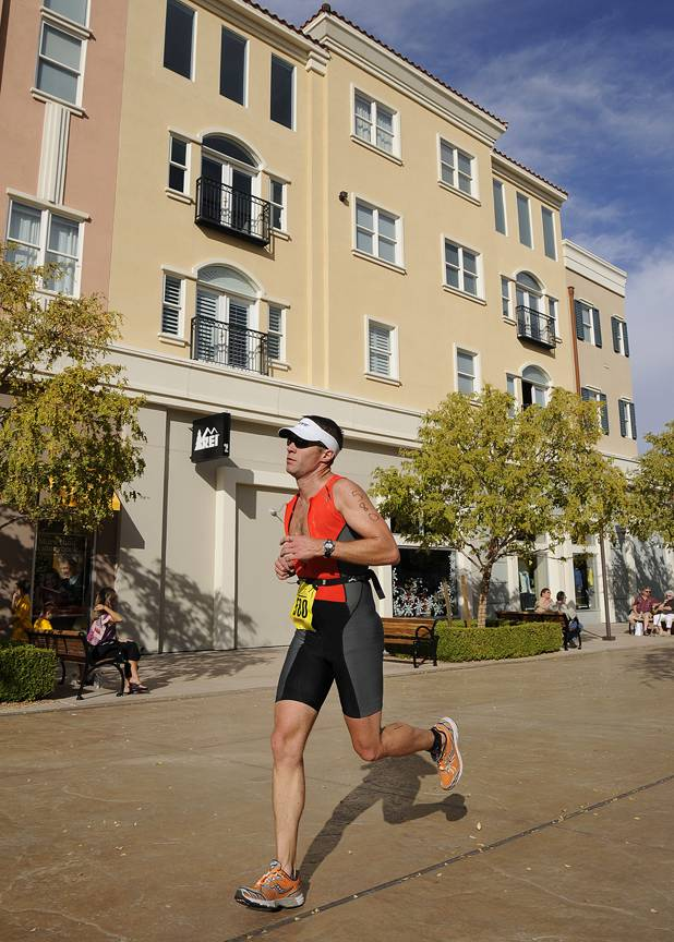 Bart Preston of Linden, Utah, makes his way through The District at Green Valley Ranch Resort while participating in the half course race of the 5th Annual Silverman Triathlon in Henderson on Sunday.