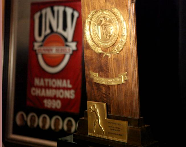 The national championship trophy is shown, won by the UNLV basketball team in 1990 with a 103-73 victory against Duke. Also on display is the banner that hangs at the Thomas & Mack Center.