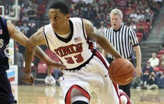 UNLV guard Tre'Von Willis drives in against Washburn during a preseason game Tuesday at the Thomas & Mack Center.