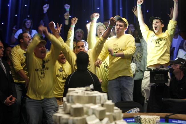 Friends and family react as Joe Cada, bottom center, a 21-year-old poker professional from Michigan, wins the World Series of Poker tournament at the Rio on Tuesday, Nov. 10, 2009. Cada got past Darvin Moon, a 45-year-old logger from Maryland, to win $8.5 million in prize money.