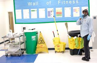 Head custodian Lori Scott gets her supplies ready to clean up during and after first-period lunch on the campus of Roy Martin Middle School in Las Vegas Tuesday, Nov. 10, 2009.