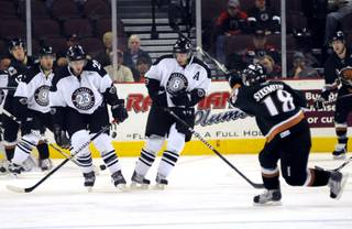 Utah forward James Sixsmith rips a slapshot between Josh Prudden, right, and Andrew Orpik during the second period at the Orleans Arena on Tuesday night.