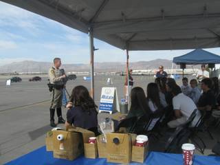 Metro police officer Richard Strader with the traffic bureau speaks to Faith Lutheran High School students about the deadly consequences of driving distractions during Allstate Insurance's Action Against Distraction Challenge on Tuesday at the Las Vegas Motor Speedway.
