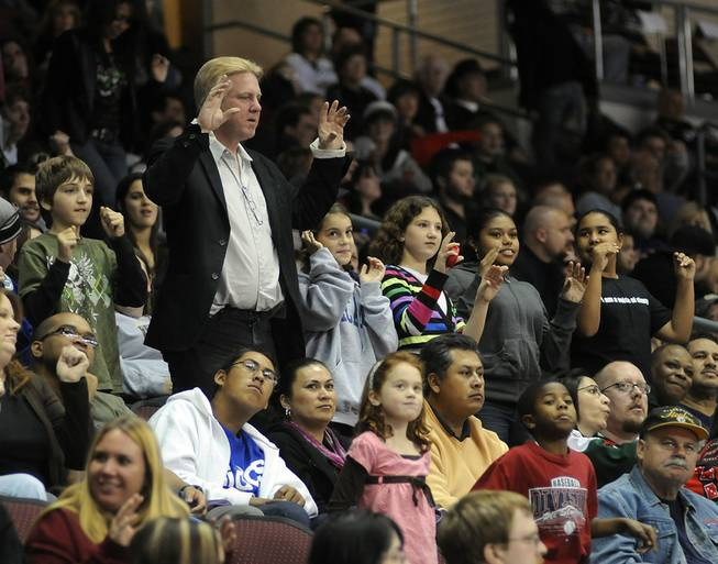 Fans perform the chicken dance during a stoppage in play at the Orleans Arena on Friday, Nov. 13, 2009. Over 6,000 attended the game between the Wranglers and the visiting Utah Grizzlies.