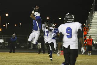 Basic wide receiver Kelly Armistead leaps for a reception over Desert Pines Friday during the Sunrise Region playoff game at Basic. The Wolves were victorious over the Jaguars 24-17.