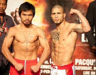 Manny Pacquiao and Miguel Cotto at their weigh-in at MGM Grand Arena on Nov. 13, 2009.