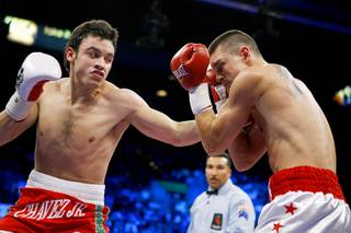 Julio Cesar Chavez Jr., left, of Mexico connects with a punch on Troy Rowland during a middleweight bout at the MGM Grand Garden Arena November 14, 2009.