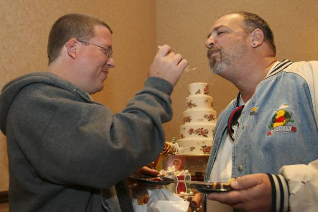 Four-year partners Michael Kutan and Gary Capone, right, sample flavors ...
