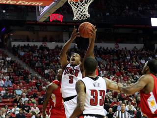 UNLV freshman Anthony Marshall looks to score Saturday against Pittsburg State in the season opener for both teams at the Thomas & Mack Center. The Rebels blew it open in the second half with a 91-52 victory.