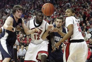 UNR forwards Luke Babbitt, left, and Adam Carp battle with UNLV forward Brice Massamba and guard Anthony Marshall as they chase down a loose ball during the first half of their game Nov. 18, 2009, at the Thomas & Mack Center. UNLV won 88-75.