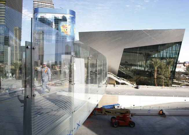 A worker uses a pedestrian bridge from the Crystals retail mall during a tour of MGM Mirage's CityCenter project Wednesday, Nov. 18, 2009. Properties in the $8.5 billion project will open next month.
