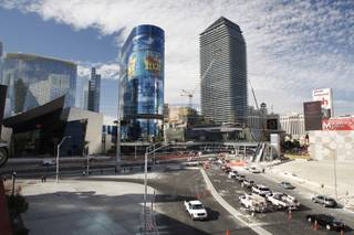 A view of Harmon Avenue and MGM Mirage's CityCenter project on Wednesday, Nov. 18, 2009. The Cosmopolitan Resort tower is shown under construction at right.