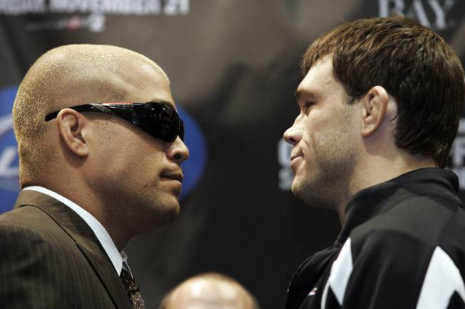 Tito Ortiz and Forrest Griffin face off at a news conference for UFC 106 Thursday, November 19, 2009.