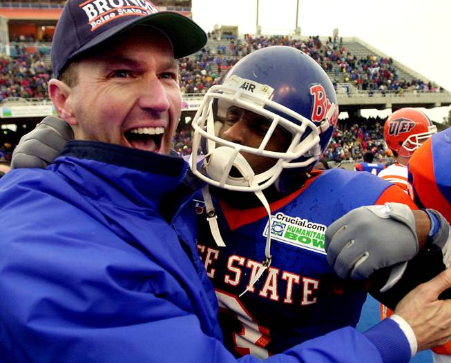 Dirk Koetter, left, celebrates with safety Shaunard Harts after Boise State defeated UTEP in the Humanitarian Bowl, 38-23, on Dec. 28, 2000. Koetter is currently the offensive coordinator for the NFL's Jacksonville Jaguars, but his name has floated around in relation to the vacant UNLV head coaching post.