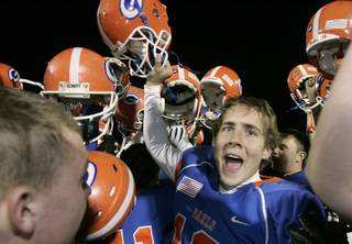 Bishop Gorman kicker Colin Ditsworth celebrates with teammates after the Gaels beat Cimarron-Memorial in the Sunrise Division championship game Friday. Bishop Gorman won the game, 31-7, to advance to the state semifinals.