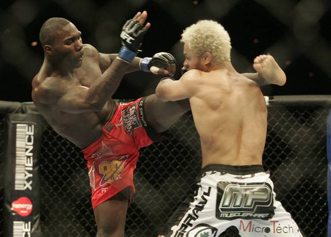 Anthony Johnson, left, kicks at Josh Koscheck during UFC 106 Saturday, November 21, 2009 at the Mandalay Bay Events Center.