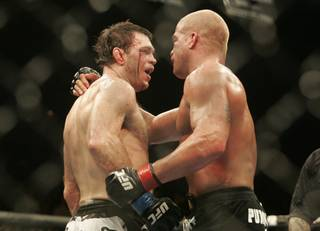 Forrest Griffin, left, and Tito Ortiz embrace following their light heavyweight bout during UFC 106 Saturday, November 21, 2009 at the Mandalay Bay Events Center. Griffin won the bout by split decision.