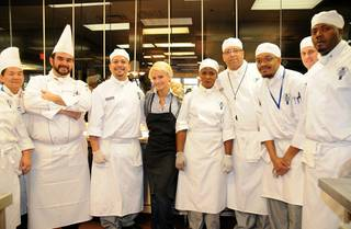Holly Madison and culinary students serve a Thanksgiving lunch to at-risk students and senior citizens at Le Cordon Bleu College of Culinary Arts on Nov. 24, 2009.