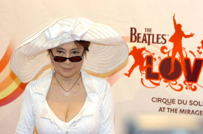"Yoko Ono, wearing a Stella McCartney hat and pantsuit, before the gala premiere of ""Love"" in June 2006."
