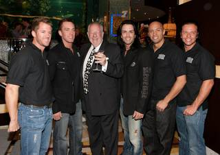 Las Vegas Mayor Oscar Goodman and Thunder From Down Under at the Golden Nugget Rush Tower Grand Opening on Nov. 23, 2009.